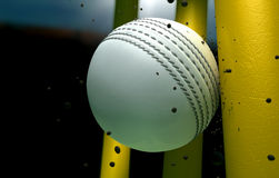 Cricket Ball Striking Wickets With Particles At Night Stock Photography
