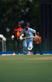 Cricket batsman. In action during ICC Cricket Youth World Cup in Kuala Lumpur, Malaysia royalty free stock photography