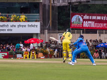 Cricket batsman bats. George Bailey of Australia bats during the cricket match in Ranchi on the 23rd of October royalty free stock images