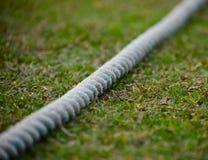 Cricket boundary rope isolated object stock photograph. The beautiful white cricket boundary rope isolated object with grass background stock photograph Stock Images