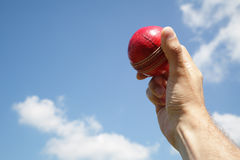 Cricket bowler with ball in hand Stock Photos