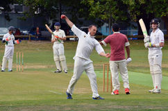 Cricket bowler warms up before game. AUCKLAND - NOV 14 2015:Cricket bowler warms up before game. A 2001 study found that bowlers who produced below 123 stock image