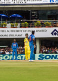Cricket confrontation. India cricketer Ravichandran Ashwin and Australia cricketer Glenn Maxwell face off during their game in Ranchi on the 23rd October Royalty Free Stock Photography