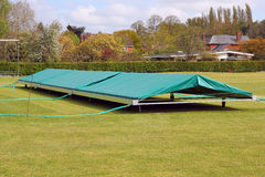 Cricket cover to protect the pitch. Royalty Free Stock Images