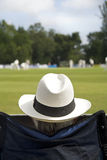 Cricket fan in sun hat Royalty Free Stock Image