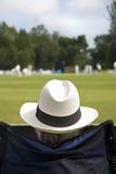 Cricket fan in sun hat Royalty Free Stock Image