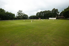 Cricket Field Oval Players Game. Scenic Cricket field oval grounds players fielding batting game stock photos