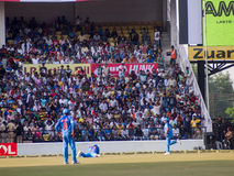 Cricket Fielder falls. Yuvraj Singh is down on the ground chasing the ball during the cricket match in Nagpur on the 30th of October royalty free stock photography