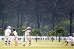 Cricket Game. Players in action in an international friendly cricket game Stock Photos