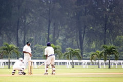 Cricket Game. Players in action in an international friendly cricket game Royalty Free Stock Images