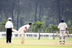 Cricket Game. Players in action in an international friendly cricket game Royalty Free Stock Photos