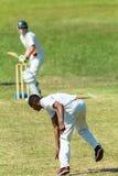 Cricket Game Action Bowler Batsman. Cricket game bowler bowling ball batsman action teenagers high schools stock images