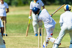 Cricket Game Action Teenagers Royalty Free Stock Photo
