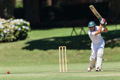Cricket Game Players Action. Batting ball play stroke action of Glenwood team batsman.  High school derby match action between Glenwood and Kearsney Boys high Stock Photography
