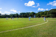Cricket Game Players Sport. Players fielding walking onto playing field for cricket game between batsmen and bowlers between Westville plays Durban Boys High 1st stock image