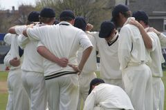 Cricket huddle Stock Photo