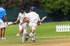 Cricket Junior Batsmen Running Stock Image