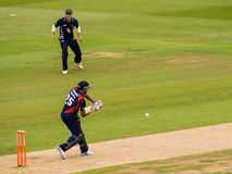 Cricket Match Batsman. Batsman Ravi Bopara playing a shot with a fielder standing by at a T20 cricket match competition. Edgbaston cricket ground, Birmingham stock photos