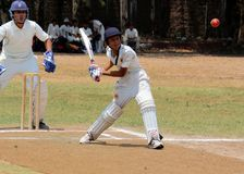 Cricket Match. Close up of Cricket player waiting for the ball to hit royalty free stock photo