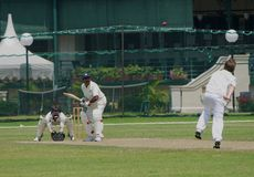 Cricket Match At Singapore Cricket Club. The Singapore Cricket Club was established in 1852, it is today one of the premier sports and social clubs in the Royalty Free Stock Photo