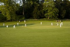 Cricket match on a summer evening ashford in the water peak dist royalty free stock images