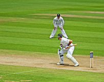 Cricket at The Oval. A game of cricket in progress at the world famous Oval Cricket Ground in London, England. This image was taken during a match between Royalty Free Stock Photos