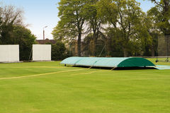 Cricket pitch in rain Royalty Free Stock Photo