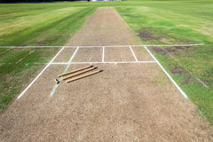 Cricket Pitch Wickets Game. Cricket pitch cut rolled and marked white batting bowling creases with wickets and bails ready for game stock photo