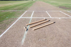 Cricket Pitch Wickets Game. Cricket pitch cut rolled and marked white batting bowling creases with wickets and bails ready for game royalty free stock photos