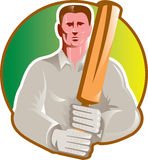 Cricket player batsman with bat front view Stock Images
