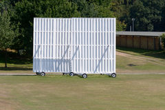Cricket sightscreen on wheels on boundary of cricket pitch Royalty Free Stock Image