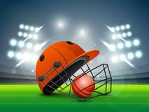 Cricket sports concept with helmet and ball. Red helmet with ball shining in night stadium lights for Cricket sports concept Stock Image