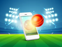 Cricket sports concept with smartphone and ball. Royalty Free Stock Image