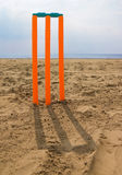 Cricket stumps on beach Royalty Free Stock Images