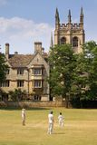 Cricket on a Sunday in Oxford. By Merton college Royalty Free Stock Image