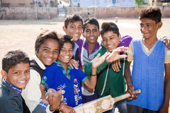 Cricket team boys, India. Jodhpur, India - 2015, January 4 : A cricket team of young boys posing for the camera with bat and ball Stock Images