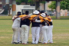 Cricket team pre game huddle. AUCKLAND - NOV 14 2015:Cricket team pre game huddle in Victoria park Auckland, New Zealand.It's one of New Zealand most popular stock photo