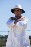 Cricket umpire signaling cancel call sign during match. Against blue sky on sunny day stock photo