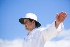 Cricket umpire signalling a boundary Royalty Free Stock Photo