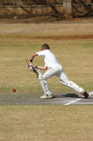 Cricketer defending. Cricketer blocking the ball Royalty Free Stock Image