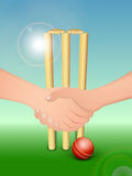 Cricketers hand shake before the match. Cricketers hand shake before starting the match with wicket stumps and ball on shiny blue and green background Stock Images