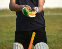 A cricketer is wearing batting gloves stock photograph. A cricket player is wearing a batting gloves in hand with natural background stock photograph Royalty Free Stock Image