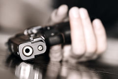 Crime. Dead woman lying on the floor holding gun in her hand Royalty Free Stock Image