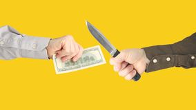 Crime against financial investments. Robbery with a knife. Threat to life. Payment for work royalty free stock photography