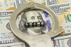Crime as a concept. On money background Stock Photos