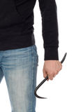 Crime concept. Criminal in hood with crowbar in hand Stock Photo