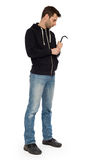 Crime concept. Criminal in hood with crowbar in hand Royalty Free Stock Photos
