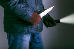 Crime concepts robbery concepts a robber aimed his sharp knife. A criminal with a knife weapon threatens to kill royalty free stock image
