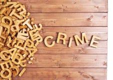 Crime da palavra feito com letras de madeira Imagem de Stock