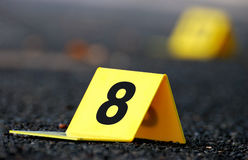 Crime Evidence Marker on Asphalt Stock Image